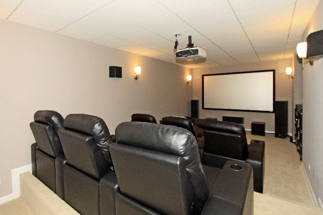 remodeled basement with recliner chairs